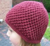 Tricoter un bonnet rond fillette