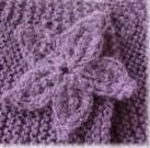Tricoter une boutonnière en fleur