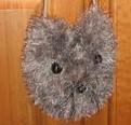 un sac en forme de tête de chat